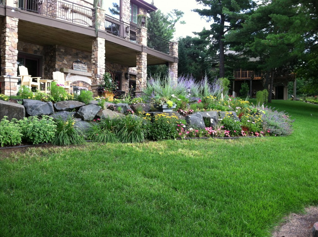 Landscaping services new richmond wi for Rock wall garden